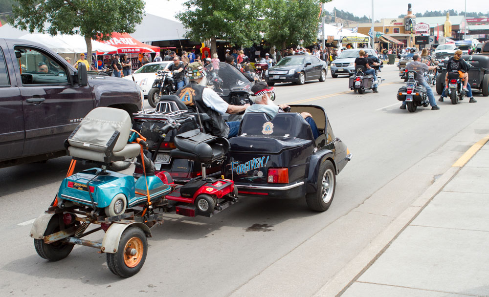 biker towing scooter