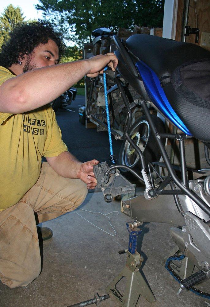 suspending brake caliper