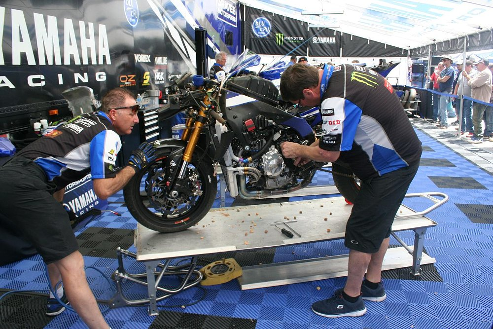 mechanics work on Josh Hayes' motorcycle