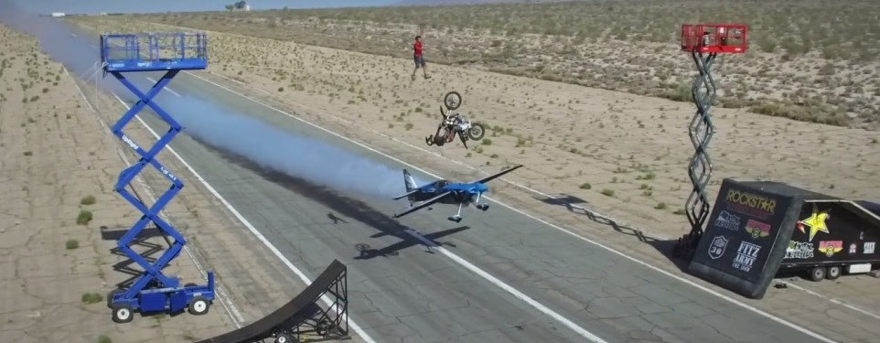 Video: A backflip, a stunt plane and a guy walking a high line