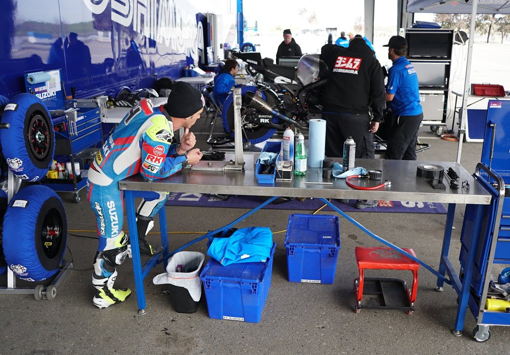 Toni Elias waits for techs to prep his bike