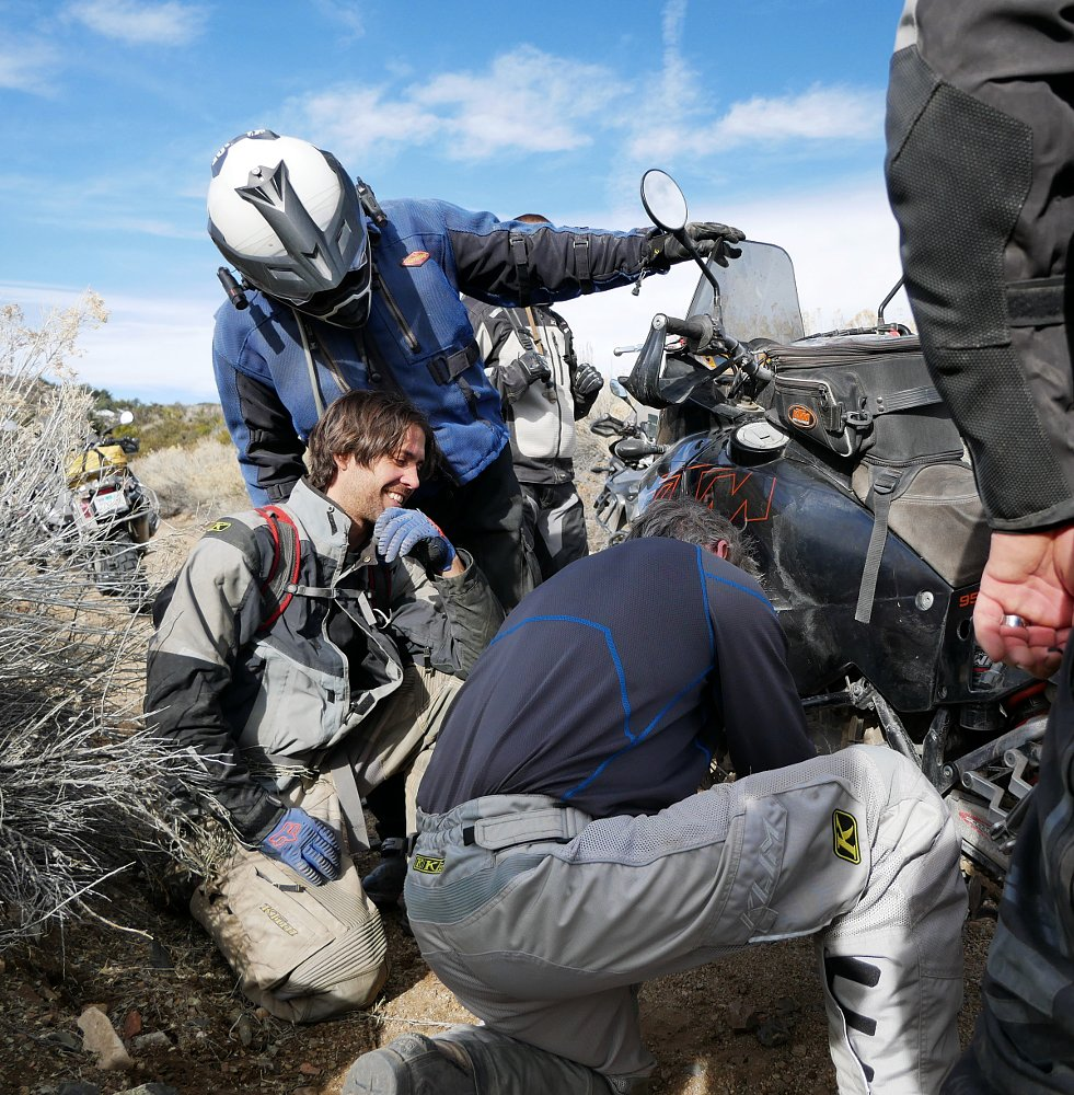 repairing a motorcycle on the trail