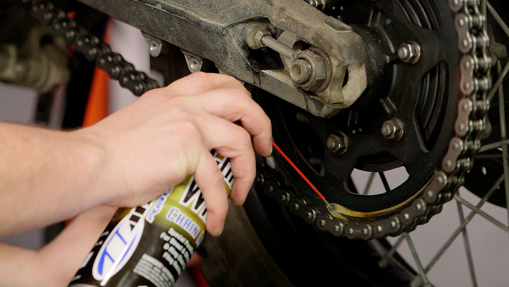 Applying Lubricant To A Motorcycle Chain