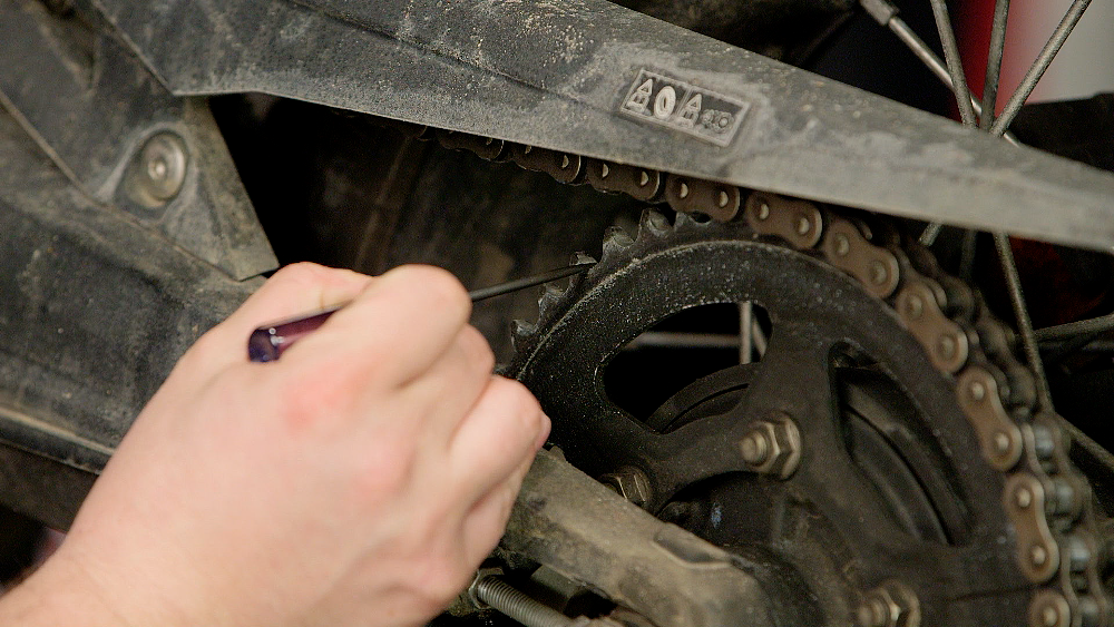 Examining A Motorcycle Chain