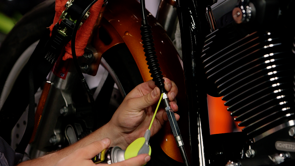 Adding silicone to motorcycle clutch cable cover