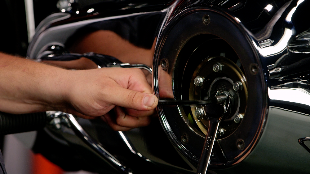 Loosening the jam nut on a clutch adjuster