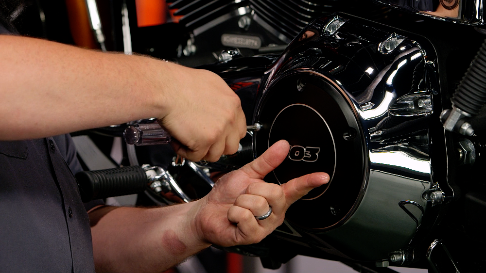 Removing a motorcycle clutch cover