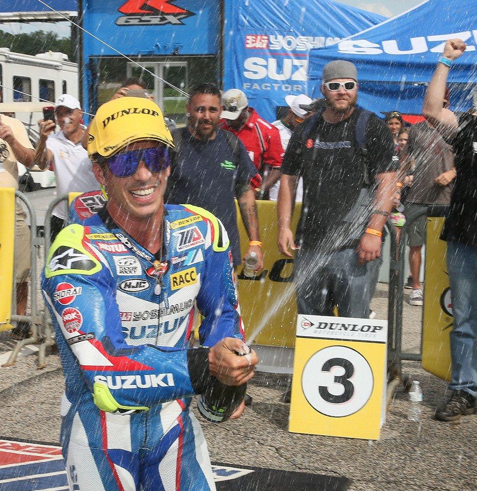 Toni Elias sprays champagne