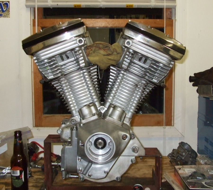 why do harley davidsons have dry sump engines revzilla and the area right under the seat was enlarged a bit to house both an oil tank and a battery a few oil lines later and h d was in the